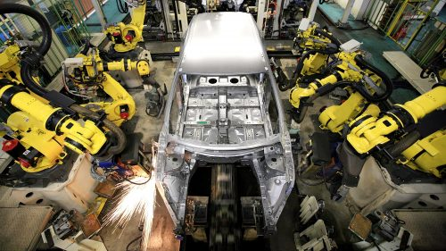Manufacturing a Nissan. Notice all the people?