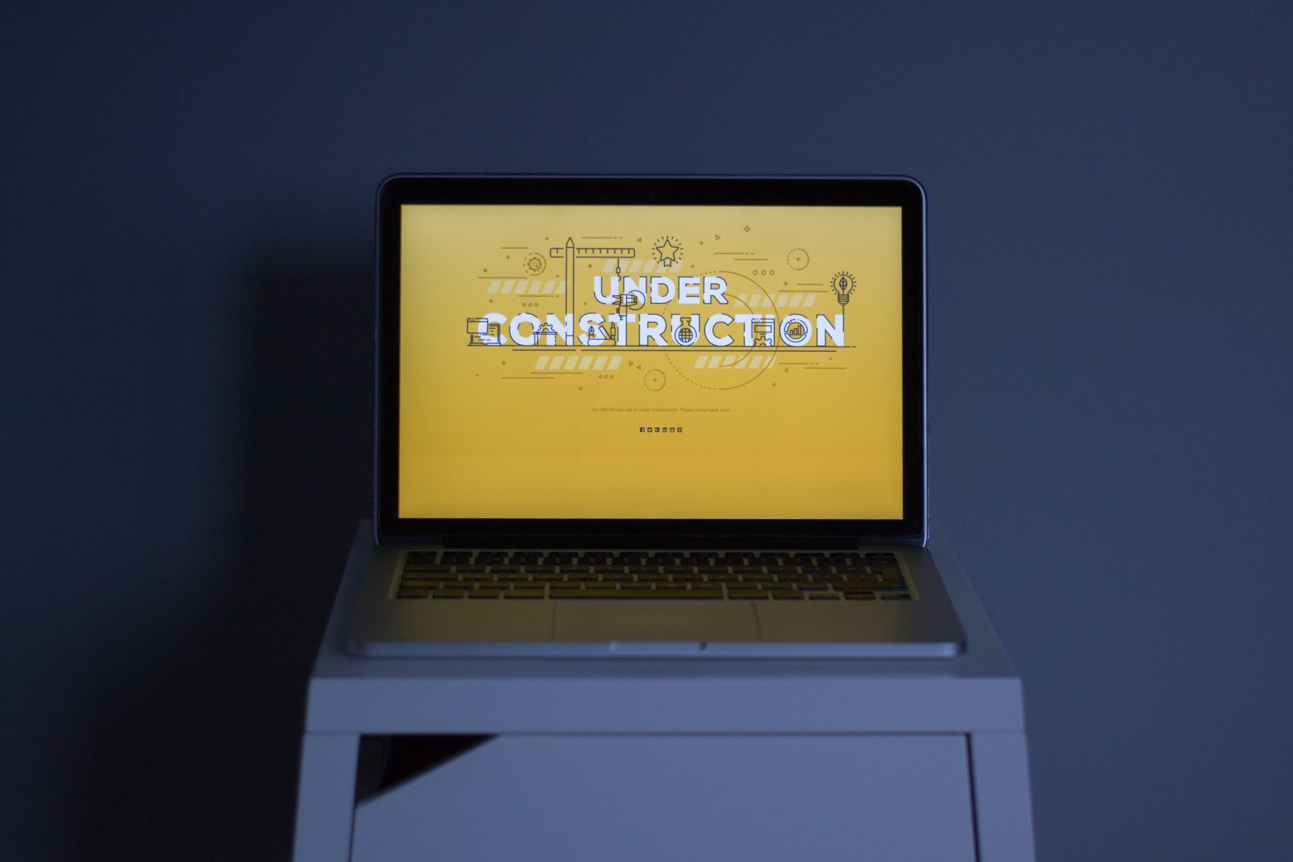 A laptop showing an under-construction page created with a WordPress plugin